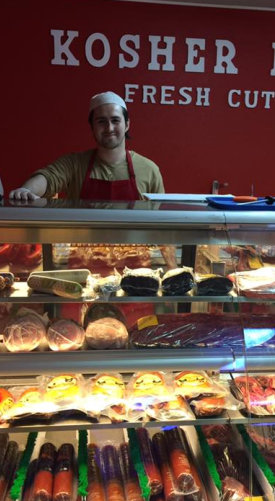 man smiling at the meatshop
